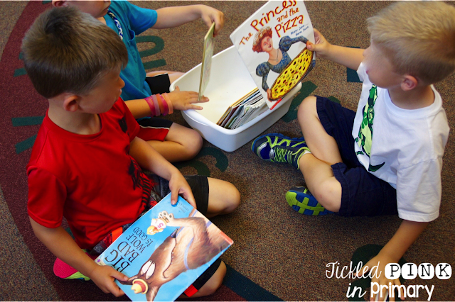 students sorting books from the classroom library