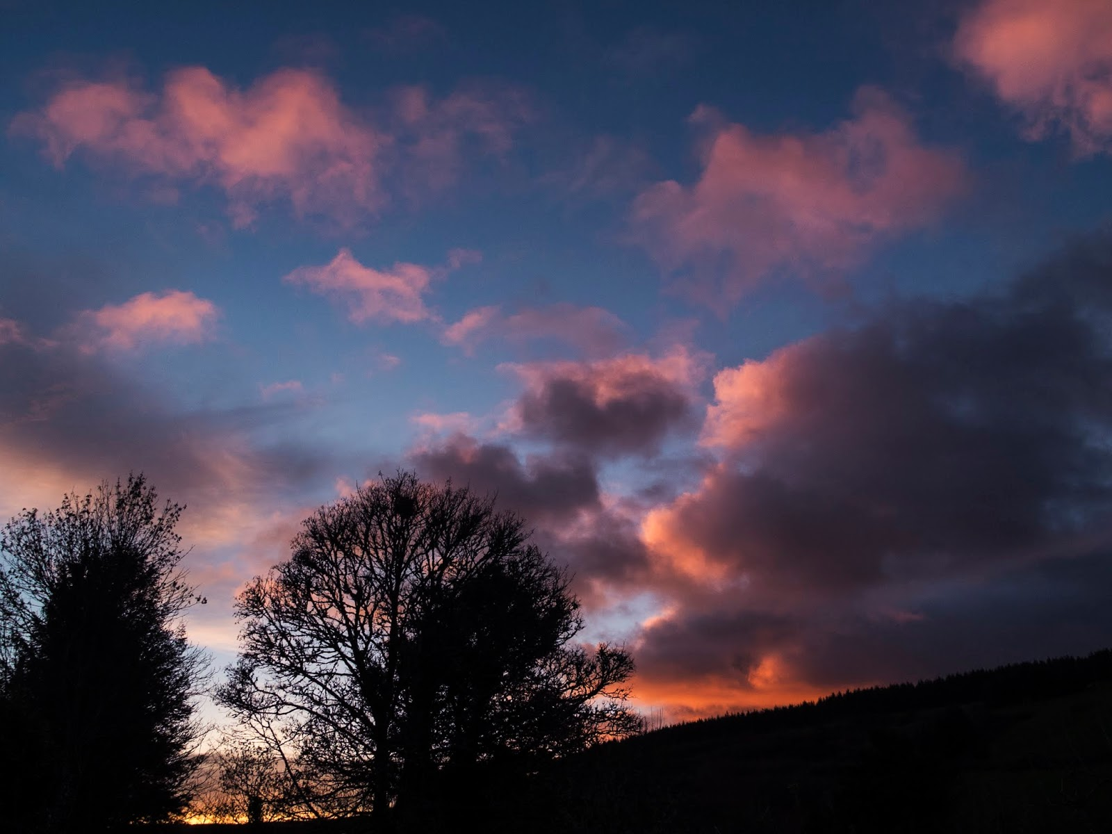 Pink and fluffy sunset clouds in a valley in the Boggeragh Mountains in North Cork.