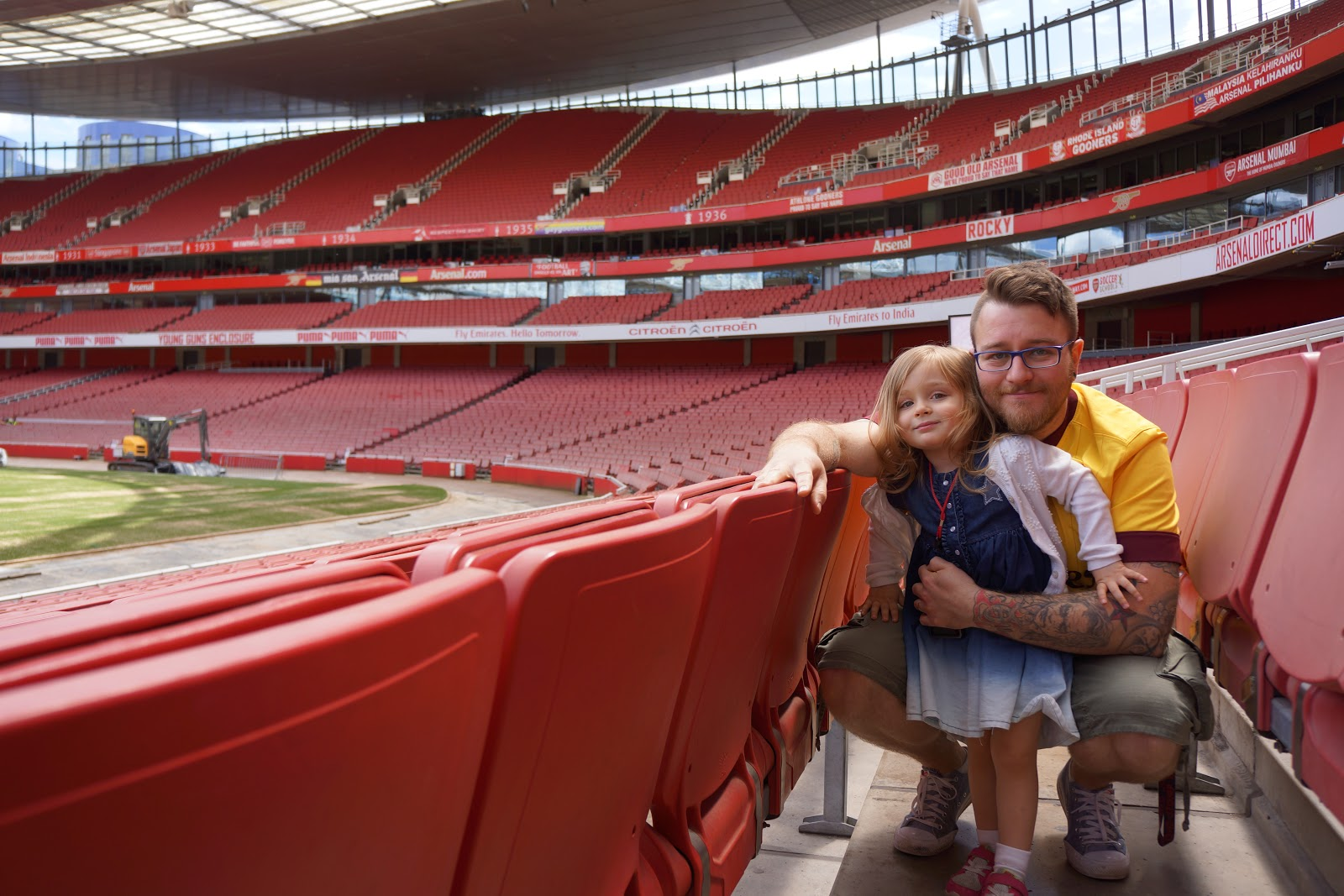 dad and daughter at Arsenal Stadium audience seats