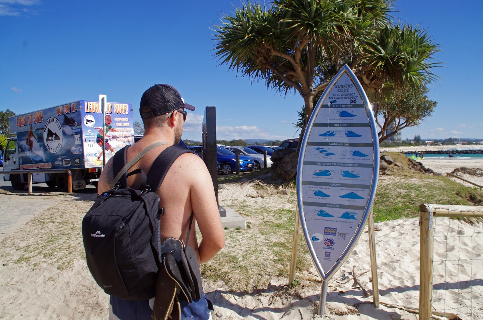 Boy with Surfing sign Currumbin Beach