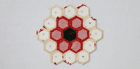 Back of Hand Sewn EPP Hexagon Block with Templates