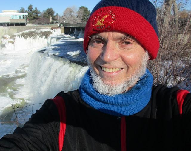 David Rain, Composer and tenor, poses with his Muse - the Rideau Falls, Ottawa, Canada