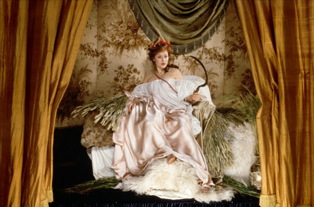Gillian Anderson as Lily Bart from The House of Mirth (2000) posing in a tableau vivant as Jean-Antoine Watteau's Ceres (Summer)