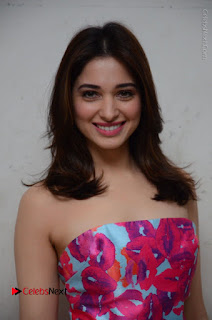 Actress Tamanna Latest Images in Floral Short Dress at Okkadochadu Movie Promotions  0074.JPG