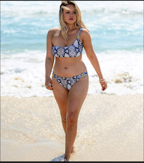 Emily Atack showed off her curves wearing a one-shoulder bikini