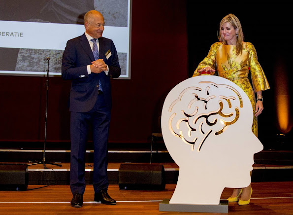 Queen Maxima opens the first anniversary congress of the Pension Federation. Queen Maxima wore Natan dress, Natan yellow Pumps