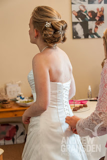 Bride with wedding hair getting ready at home before the ceremony