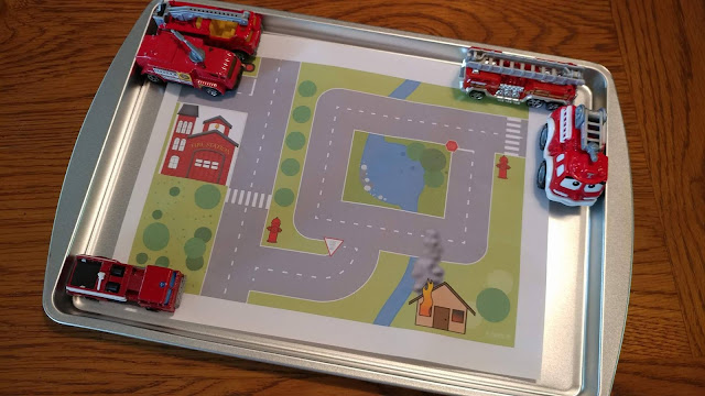 Printed scene with toy fire trucks