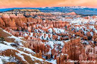 Professional quality landscape or nature photograph of Bryce Canyon dusted with snow at sunset in Utah by Cramer Imaging