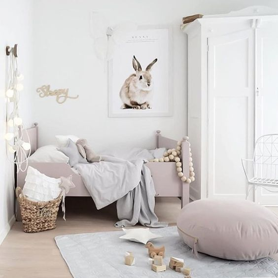 Gorgeous girls room with rose pink and bunny on wall