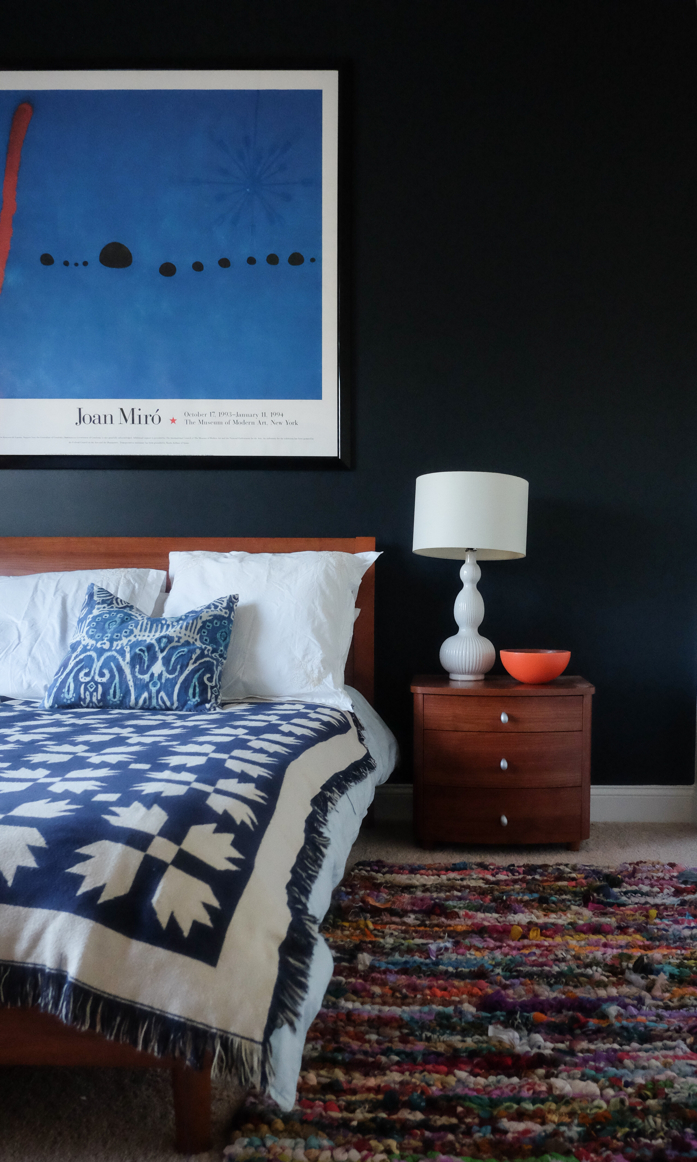 Dark and moody bedroom with rich layers-designaddictmom