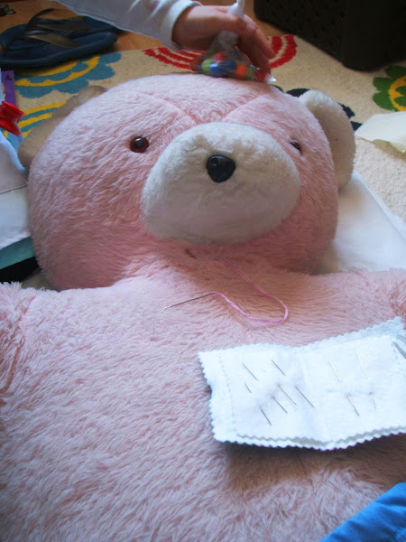 mending an old teddy bear