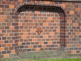 Terracotta tile in brickwork
