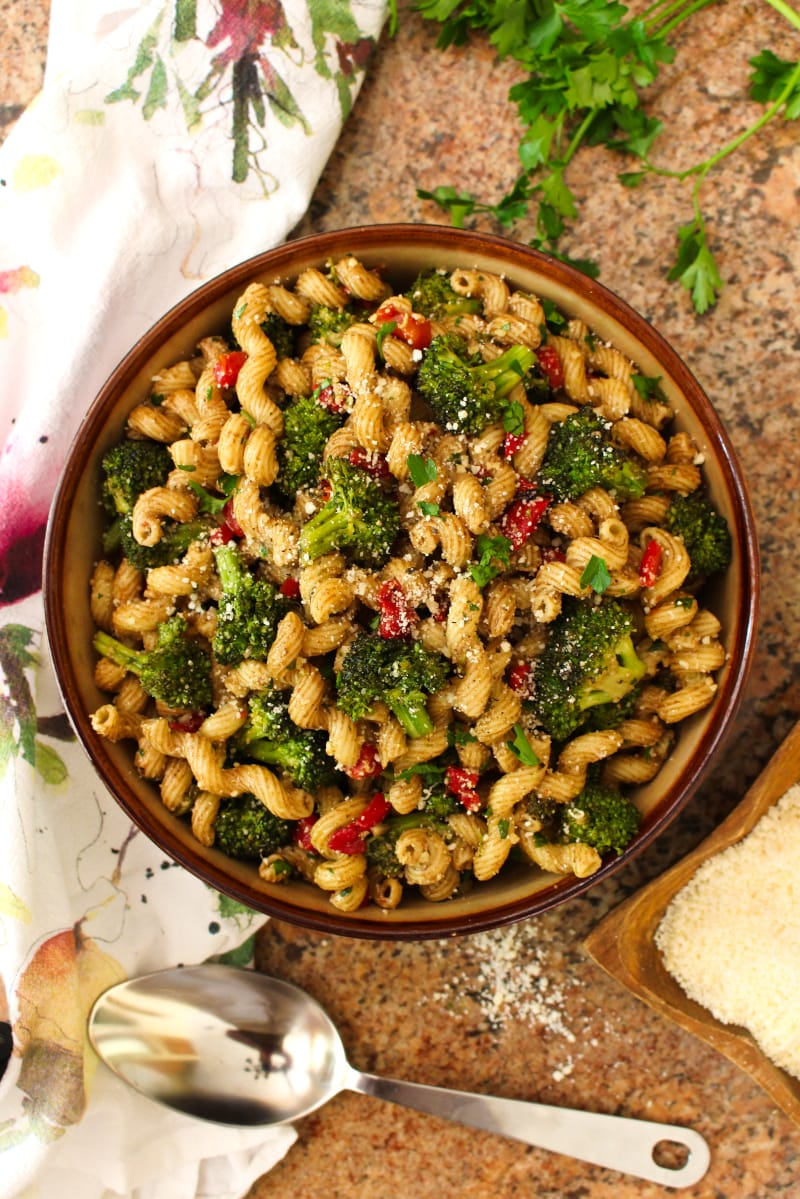 This Broccoli Pasta Salad is the perfect summer side dish for broccoli lovers! Tender-crisp pan-seared broccoli florets are tossed with cavatelli pasta, roasted red peppers, parmesan cheese, and zippy balsamic vinegar in this unforgettable, party-perfect salad. #broccoli #sidedish #pastasalad
