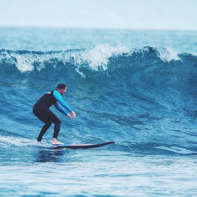 kuta beach bali surfer