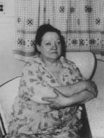 Mary Ellen sitting in chair