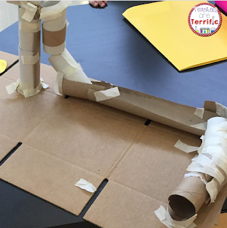 STEM Challenge: Build a marble run! It's totally made from cardboard tissue rolls and tape. So easy to assemble and so much fun!