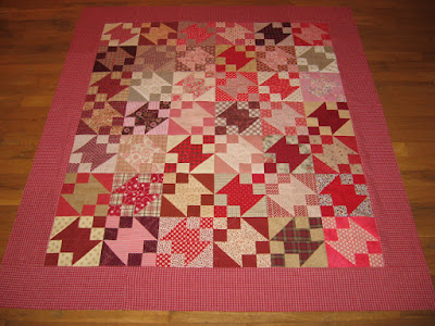 red scrappy Buckeye Beauty quilt