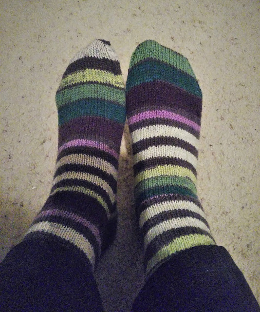 socks knit with 2 different dye lots of Paton's Kroy sock  yarn. Colorway is Bramble Stripes