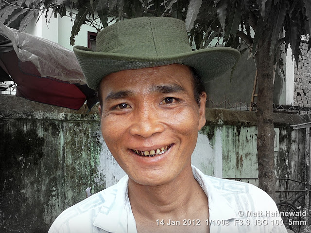 Burma, Myanmar, Yangon, Burmese man, people, portrait, headshot, focal black and white, green bush hat