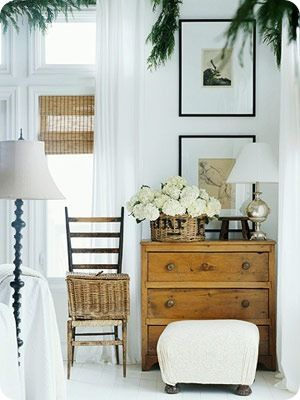 Country decor with vintage chest, rustic basket, and hydrangea