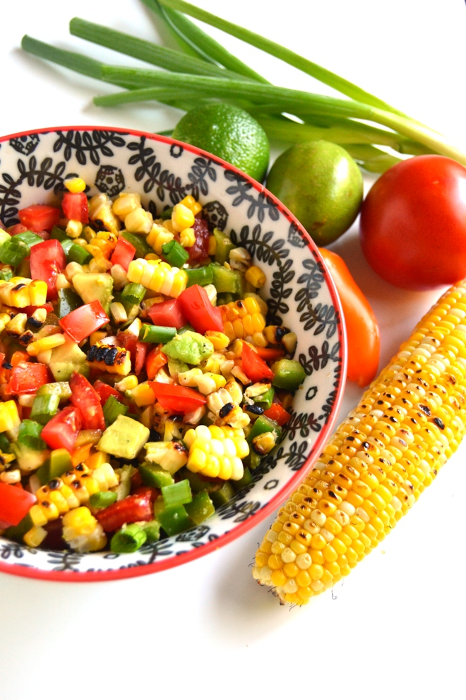 Avocado Grilled Corn Tomato Salad makes the perfect flavorful appetizer or side dish for any party and is tangy with a homemade lime dressing! www.nutritionistreviews.com