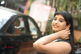 Actress Model Poorni Stills in Floral Long Dress at Silk India Expo Launch  0035.JPG