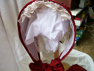 Cap or lace ruffle inside bonnet.