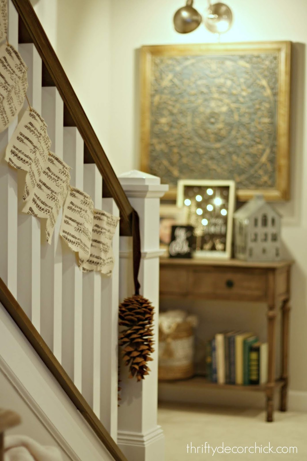 Holiday music garland on stairs