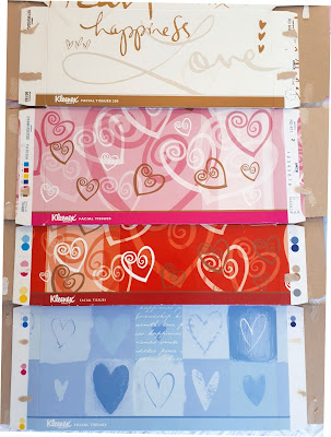 Selection of four flattened tissue boxes with heart designs on them.