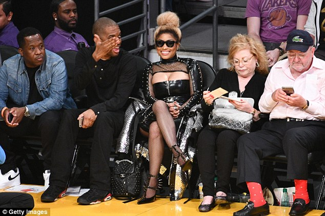 Nicki Minaj flashes cleavage in sexy black leather ensemble at Los Angeles Lakers game