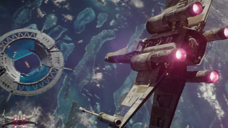 An X-Wing makes a daring move to fly through a closing shield in Rogue One.