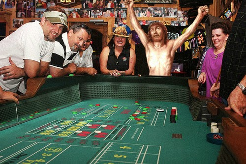 Funny crucified Jesus pose - Jesus playing craps in a casino
