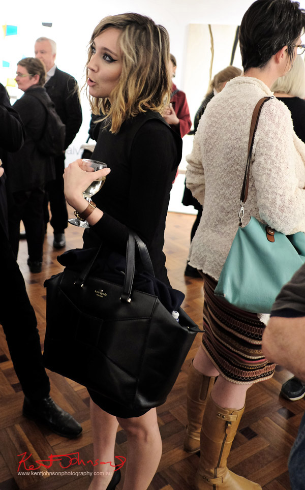 Black on black on black bag, retro eye make-up. Photo by Kent Johnson for Street Fashion Sydney.
