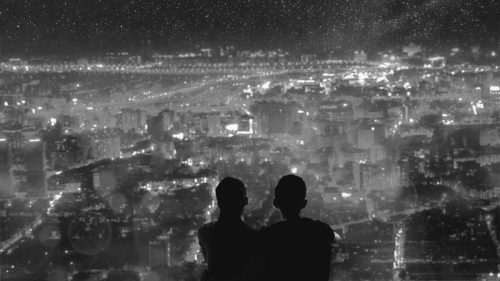 couples sit city lights