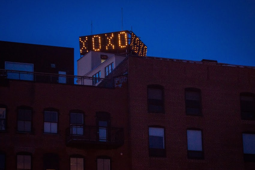 Portland, Maine USA February 2016 Valentine's Day message XOXO on the Time and Temperature Building sign.