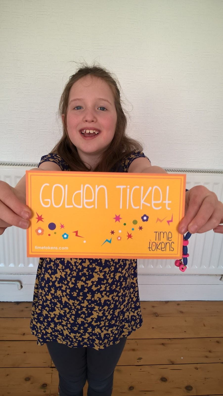 Caitlin Hobbis holding the Time Tokens Golden Ticket - Children's Product Reviews - motherdistracted.co.uk