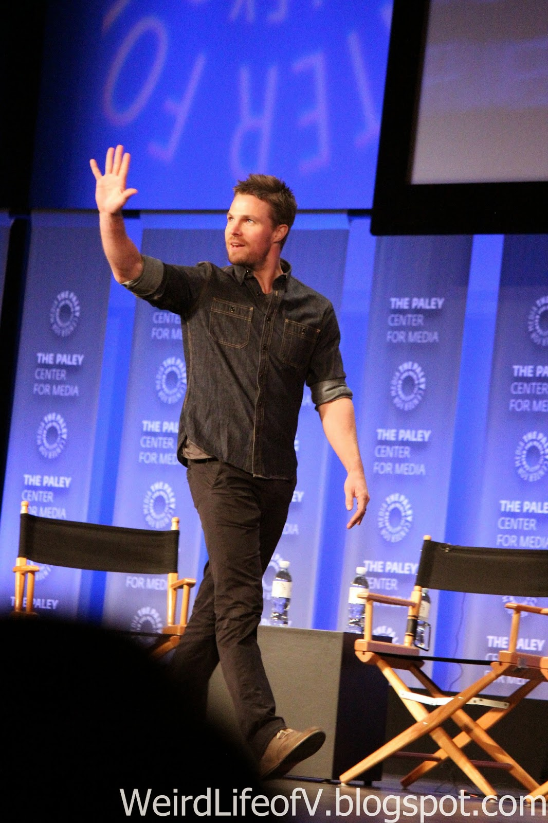 Stephen Amell walking on stage