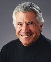 Steve King smiling in black turtleneck shirt