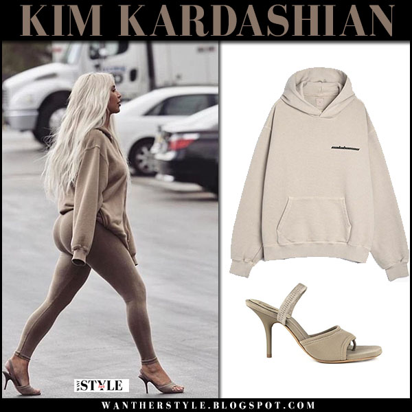 Kim Kardashian in beige hoodie, brown leggings and sandals yeezy tech slingback street fashion february 17