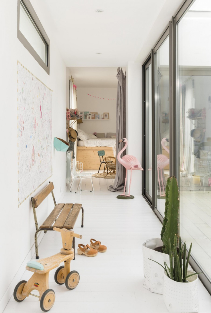 Bright hallway with succulents and kid's accessories -design addict mom