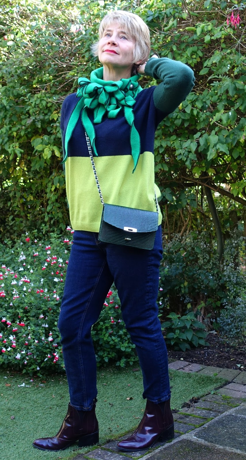 Image showing a loose jumper worn with a Rew scarf, jeans, ankle boots and a cross-the-body bag