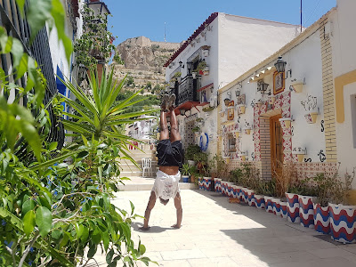 Mosaiced houses with castle background only need one thing - a handstand