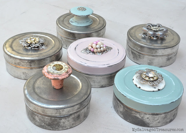 collection of decorated vintage movie film canisters