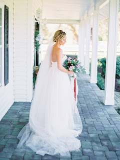 bride in wedding dress with bouquet