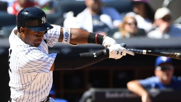 Yankees blast four homers in rout of Twins