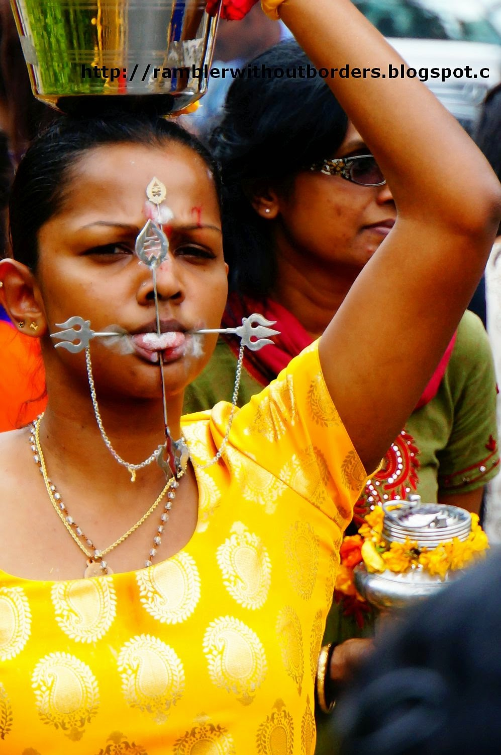 devotees with tongue piercings in Thaipusam Festival, Singapore