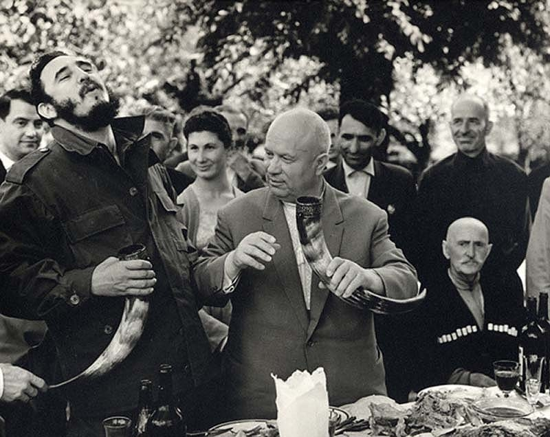 Fidel Castro and Nikita Khrushchev drinking wine from a drinking horn in the Soviet Republic of Georgia, 1963