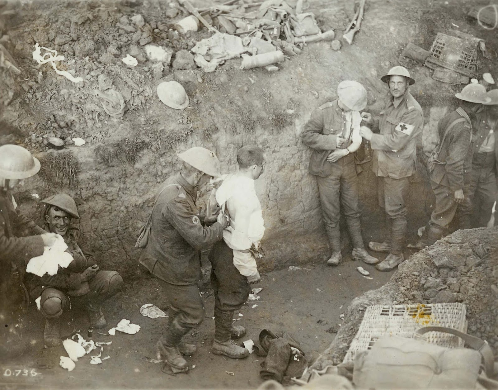 Medical orderlies tend to the wounded in a trench during the Battle of Flers-Courcelette in mid-September 1916. The man on the left is suffering from Shell Shock.