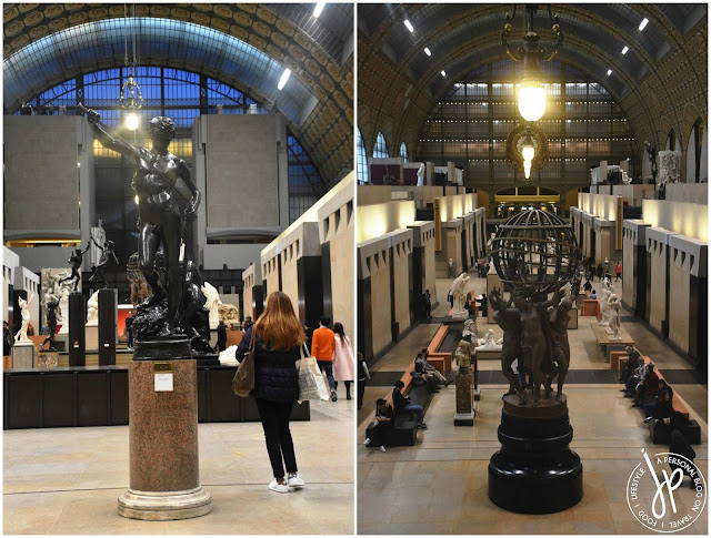 man statue, globe statue inside museum
